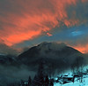Winter wonder (Robyn Hooz) Tags: tramonto sunset winter inverno nuvole arancione cielo sky clouds neve snow cima peak rocks rocce ase houses cadore venas