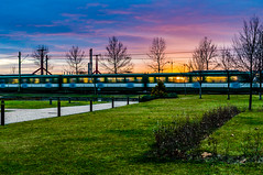 DSC05958-5 (Bence Boros) Tags: sony alpha a77m2 a77ii 35mm f18 classic focallength golden hour budapest city hungary hév train park trees grass plants sky clouds fabled colors path