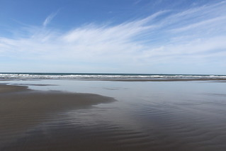 Nothing but wet sand on Merchants Beach