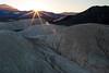 Daybreak (James Marvin Phelps) Tags: deathvalleynationalpark california deathvalley twentymuleteamcanyon sunburst sunrise sunrisecolors photography jmpphotography jamesmarvinphelps jamesmarvinphelpsphotography