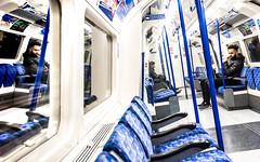 Journey of Thought (DobingDesign) Tags: tube tubetrain tfl transportforlondon london londonunderground seats blue pattern travel commuter passengers deepinthought reflection northernline thinking