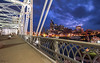 Shelby Street Pedestrian Bridge - Nashville (Tennessee) (Andrea Moscato) Tags: andreamoscato america statiuniti usa unitedstates us night notte notturno dark darkness light luci ombre shadow sky cielo clouds city città nuvole cityscape blue white yellow red evening ponte bridge iron architecture architettura street strada structure road fiume river reflection riflesso buildings edificio skyscraper skyline historic view vivid vista overlook panorama