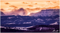 Fire and Ice Sunset (Moe Ali Photography) Tags: mountains rockies rockymountains foothills alberta clouds mist glow sunset surreal magical peaceful telephoto landscape trees forests farm canon5dii sigma120300f28 14xtele 420mm outdoors snow capped winter peaks compressed
