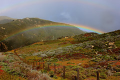 Rainbow (Eduardo Ruiz M.) Tags: rainbow landscape sky mountain fence grass storm stormy cloudy weather