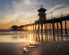 Surf Board Sunset (debbie_dicarlo) Tags: huntingtonbeach huntingtonbeachcalifornia huntingtonbeachsunset beachsunset sunset beach california surfboards surfboardsonthebeach pier sky