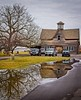 Winery Reflected in the Puddle (otterman51) Tags: building canada grimsby hamilton landscape niagararegion ontario ortbaldauf tree cold farm niagara ortbaldaufcom outdoors photography sky vineyards vintage water winery winter