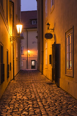 Night descends in Prague (Wayne Huzzey) Tags: 2015 afternoon alley alleyway botega cafe caffe caffebotegalaundry českárepublika česko cobble cobbled cobbles czech czechrepublic czechia dark december door europe european evening holiday hotel jiříhočerveného kampa lamp lamps landscape landscapes lane laundry lesserquarter lesserside lessertown light lights littleside malástrana nakampě narrow night nighttime nikon nikonafsnikkor2470mmf28ged nikond800 path picturesque prag praga prague prague1 praha praha1 quaint quiet sign signs street streets travel vacation wet windows winter wood wooden sky dusk long exposure