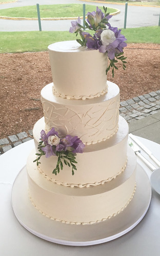 Alternating Textured Buttercream Wedding Cake with fresh flowers
