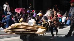 work till you drop (Winedemonium2) Tags: old woman barrow pusher grey hair security guard winter hong kong central hsbc cart cardboard collector street