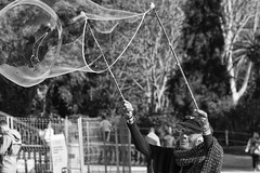Creating fantasy (TheLionPo) Tags: people gente woman mujer blackwhite bw blackandwhite barcelona byn fantasy bubble burbujas old blancoynegro parks parque ciutadella citylife