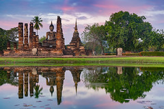 Sukhothai Historical Park (baddoguy) Tags: ancient civilization archaeology architectural column architecture asia awe beauty in nature blue buddha buddhism building exterior built structure city cloud sky cloudscape color image complexity cultures dramatic dusk famous place horizontal landscape majestic mirror moody no people old ruin outdoors palace photography reflection religion rural scene southeast sukhothai historical park sunlight sunrise dawn sunset temple thai culture thailand tourism travel destinations unesco world heritage site unusual angle wat mahathat water
