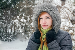 Young Redhead Woman Outdoors in Winter Snowfall with Snowflakes (blurMEDIA Stock) Tags: afternoon blizzard coat cold earmuffs fashionable fauxfur february freezing frozen fur girl green hike hiking hood ice icy january mother natural perfect person redhead scarf season seasonal snow snowcovered snowflake snowing snowstorm snowy storm trendy walk walking white wife winter woman young