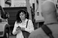 People on Market St 123 (TheseusPhoto) Tags: blancoynegro blackandwhite monochrome noir people streetphotography street city citylife sanfrancisco sanfran california marketstreet portrait woman headphones listening