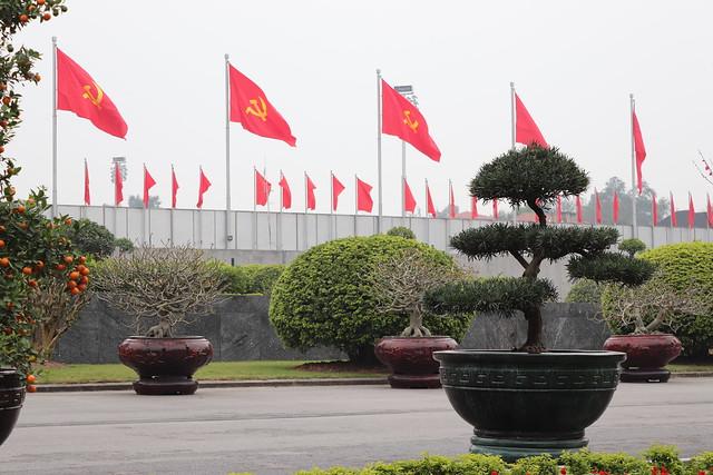 vietnam hanoi hochiminh mausoleum flags communist hammerstickle plants tree pot wall bonsai
