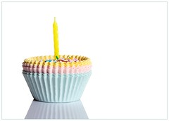 Birthday Candle (Karen_Chappell) Tags: birthday holiday white yellow candle blue pink pastel stilllife cupcake paper sprinkles multicoloured happybirthday
