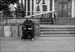 DR150911_0021D (dmitryzhkov) Tags: russia moscow documentary street life human monochrome reportage social public urban city photojournalism streetphotography people bw dmitryryzhkov blackandwhite face portrait streetportrait disabled invalid ill door gate everyday candid stranger rogue beggar religion church