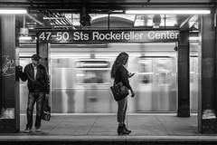 Rockefeller Center (John St John Photography) Tags: rockefellercenter 4750 streetphotography candidphotography subwaystation mta newyorkcity newyork commuters blur slowshutterspeed bw blackandwhite blackwhite blackwhitephotos johnstjohn