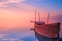 Old fishing boat (Artur Rydzewski) Tags: boat fishingboat old rusty water colours clouds sky sea ocean orange blue rustyboat