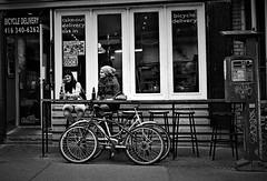 Girlfriends, Toronto (L55ZJNIT6B2KYV5V62Z4HAWSXZ) Tags: women beer restaurant street urban t3 contax film scanned kensingtonmarket bikes