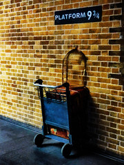 Platform 9 3/4 (Steve Taylor (Photography)) Tags: platform934 cage trolly suitcase king'scross train station art sculpture wall blue black brown sign fun weird crazy mad odd strange brick uk gb england greatbritain unitedkingdom london wheels luggage