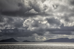 Traveling to North Uist (Joost10000) Tags: sky clouds drama atlantic seascape sea ocean landscape mountain sunshine reflections water scenic outdoors scotland uk unitedkingdom greatbritain britain europe canon canon5d eos