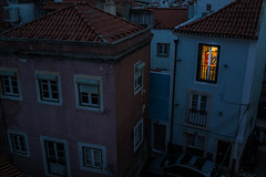 a short story about one bright window in the dark (ignacy50.pl) Tags: cityscape dark evening light windows building architecture oldtown oldstret night lisbon alfama oldstreet colorful