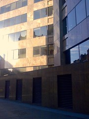 Shiny facade (my morning walk to Prescot Street) (David Ian Ross) Tags: edwardhopper dig prescotstreet city morning august2008 commute london building architecture window glass marble fascia sunlight nokia cameraphone lowres memory