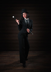 Tuxedo wearing woman (FotoMaggi) Tags: oneperson studioshot women people standing adult blackcolor females suit businesswoman 2018 holding youngadult hat business caucasianethnicity elegance