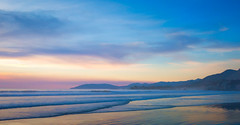 Pacific Pastels (byron bauer) Tags: byronbauer pacific ocean coast beach sunset pastel pismobeach california sea water waves surf sky clouds smoke yellow orange pink blue coastline landscape seascape painterly magichour hills mountains