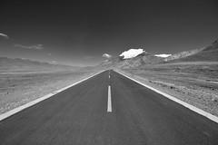 The Long Empty Road (Tibet) (Harald Philipp) Tags: tibet friendshiphighway highaltitude touring tourist tourism nepal china socialism communism buddhism g318 nikon d810 snow himalayas lhasa xigatse tingri wasteland desert altitude