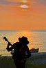 As The Sun Goes Down (swong95765) Tags: sun sunset water ocean silhouette music banjo man musician