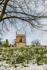 Snowdrops at Babworth Church (Cerdic Elesing) Tags: kodakektar churchtower england winter church snowdrop babworth snow clock flower churchyard nottinghamshire xequals unitedkingdom gb
