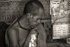 Getting rid of earthly attachments is NOT traveling light (J316) Tags: hebrews416 monk poor light bw monochrome old j316 a77 sony thailand buddhist burdens pride life sacrifice enlightened dark peace joy