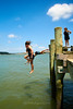 Pahi Beach 008 (C & R Driver-Burgess) Tags: teen young boy girls leap jump harbour wharf sea kaipara brother sister girlfriend nephew niece son daughter shorts halter top green blue clear sky sunny summer splash