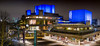 The National Theatre (Panorama) (DobingDesign) Tags: panorama architecture nightcolours nightshot nighttime brutalistarchitecture brutalist geometric darkandlight litup illuminated signage denislasdun brutalistbuilding iconicbuildings iconiclondon london thenationaltheatre nt cityinthedistance thameside lighting lines modernarchitecture building people publicrealm