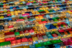 Aerial view of  night market in Bangkok city , Thailand. And colourful tents (MongkolChuewong) Tags: aerial architecture asia bangkok blue building business city cityscape clouds colourful day dinner district downtown eat food high landmark landmarks landscape light local market night park popular restaurant selling shadow shop shopping sky skyline skyscraper street sunny sunset symmetric tents thailand tower town travel traveller tropical urban vertical view walk