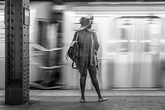 W4 (John St John Photography) Tags: streetphotography candidphotography west4thstreet subwaystation newyorkcity newyork sixthave woman waiting train commuter patiently slowshutterspeed blur bw blackandwhite blackwhite blackwhitephotos johnstjohn