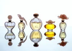 Perfume Bottles (Karen_Chappell) Tags: glass stilllife perfume cologne bottles reflection bottle product mirrored mirror five 5 heart bird shapes shape flower crystal yellow white orange blue