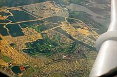 Late August 1992 - Historic early morning aerial view of Lake Joondalup, Joondalup City & Joondalup Country Club north of Perth, Western Australia, Australia (aussiejeff) Tags: jetplane scanned canoscan8800f tamron28300mmafzoom 35mm agfaxrs100 vhfki fellowship fokkerf284000 twinjet ansettwa viewfromwindow viewfromaplane australia westernaustralia historic aussiejeff jeffc 90s 1990s 1992 flying australianaviation aircraft aviation joondalup lakejoondalup joondalupcity oceanreef connolly currambine malupisland hodgesdrive marmionavenue suburbia suburban aerialphoto