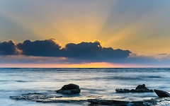 Sunrise Seascape and Sun Rays (Merrillie) Tags: daybreak sunrise nature australia crepuscularrays sea sky centralcoast newsouthwales rocks toowoonbay nsw morning beach ocean sunrays clouds earlymorning coastal landscape outdoors seascape waterscape coast water dawn