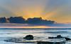 Sunrise Seascape and Sun Rays (Merrillie) Tags: daybreak sunrise nature australia crepuscularrays sea sky centralcoast newsouthwales rocks toowoonbay nsw morning beach ocean sunrays clouds earlymorning coastal landscape outdoors seascape waterscape coast water dawn