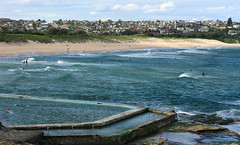 Rock Pool and Curl Curl Beach (philipbouchard) Tags: beach ocean waves sand sunshine curlcurl south australia sydney newsouthwales nsw pacificocean shore swimming wading water whitecaps beachside recreation people suburbs pool rockpool saltwater tide walls northernbeaches coast
