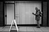 2018_023 (Chilanga Cement) Tags: fuji fujix100t fujix100f x100t xseries x100f x100s x100 bw blackandwhite monochrome candid man reading hat newspaper street streetphotography win reflection