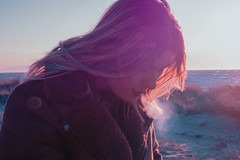 Venus Bonus (cheesy Pinterest edition) (Gio Pagonis) Tags: sunset beach water sky people model photography portrait landscape colour aesthetics youth grunge grain blue purple new outside hair smoke waves flickr olympus omd em10 nature beauty girl lady woman venus