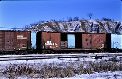 Rock Island boxcar patched for Union Pacific in 1981 0251 (Tangled Bank) Tags: train trains railway railways railroad railroads north american old classic heritage vintage rolling stock freight cars equipment rock island boxcar patched for union pacific 1981 0251 ri crip up