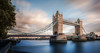 London Tower Bridge and Blue River Thames (Jacob Surland) Tags: architecture art bridge building caughtinpixels city cityscape clouds country england fineart fineartphotography greatbrittain jacobsurland landmark light london londontowerbridge longexposure oldbuilding river riverthames uk unitedkingdom warmlight water