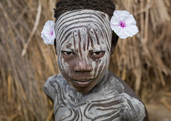 Mursi tribe boy wearing makeup and flowers, Omo valley, Mago National Park, Ethiopia (Eric Lafforgue) Tags: abyssinia adornment africa african africanethnicity africantribe boy child childhood coloredpicture colour contemplation decoration decorative developingcountries eastafrica ethio3439 ethiopia face flowers headandshoulders horizontal hornofafrica humanbeing innocence kid lookingatcamera magopark makeup mursi omo omovalley oneperson ornament outdoors people photography portait realpeople serious tribal tribe visage youth