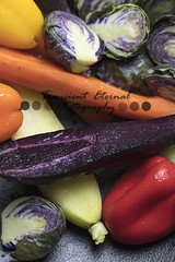 Mixed purple Brussels Spouts, colorful carrots and yellow, red and orange bell peppers being prepped for pan roasting in the oven (Transient Eternal) Tags: brusselssprouts vegetables roastedvegetables lunch dinner food sweet savory dish meal salty leafy veggie cruciferous brassicacea cabbage brassica plated cuisine gourmet baked sauteed gemmifera healthyfood nutritious nutrition delicious servingbalsamicdrizzle parsley garnish appetizer sidedish pan carrots yellowpeppers orangepeppers peppers purplecarrots daucuscarota capsicum colorfulvegetables purplebrusselssprouts cooking cook rawvegetables vegan vegetarian