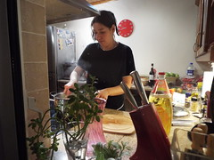 Busy in the kitchen (sean and nina) Tags: nina serb kitchen cooking baking night indoors inside black clothes brunette hair face brown eyes pink lips arms hands neck throat knives clock belfast northern ireland irish eu europe european busy beauty beautiful gorgeous stunning charm charming woman lady girl girlfriend fiancee wife married bottles wine sauce candid window unposed