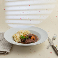 Boeuf en Daube Provenal served with noodles. (annick vanderschelden) Tags: boeufendaubeprovenal pressurecooker beefstew beef stew daubire casserole coveredcasserole simmered marinating wine flavor ingredients cooker redwine garlic dreidthyme bayleaves tomatopaste anchovyfillets chuck pieces onion blackolives blackpepper carrots parsley bowl noodles belgium boeufendaubeprovençal daubière